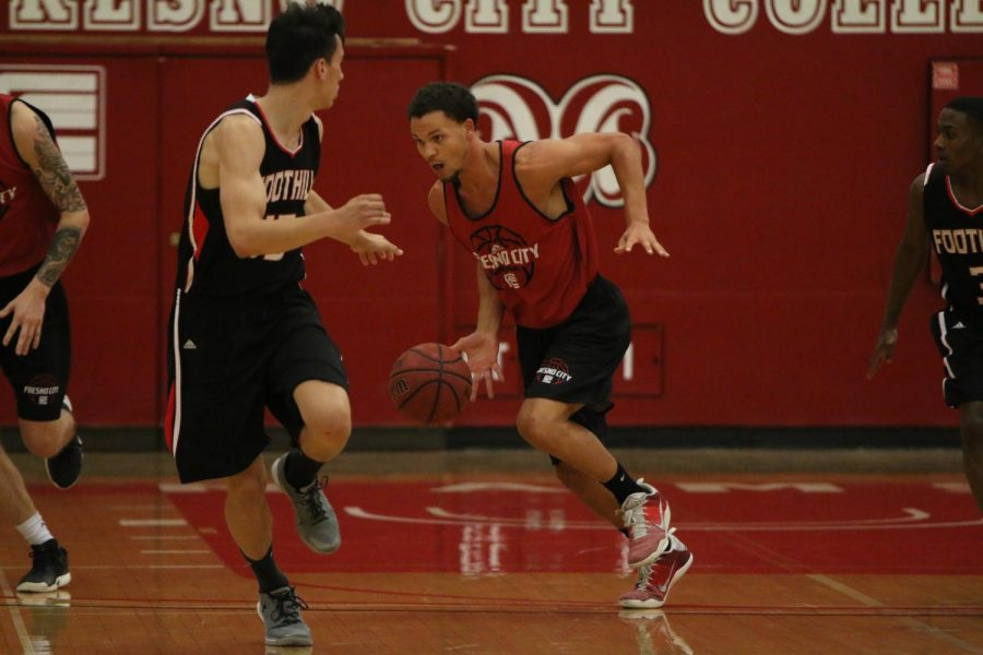 Fresno City College basketball player takes advantage of a fast brake during an exhibition game at home against Foothill College on Thursday, Sept. 28, 2017.