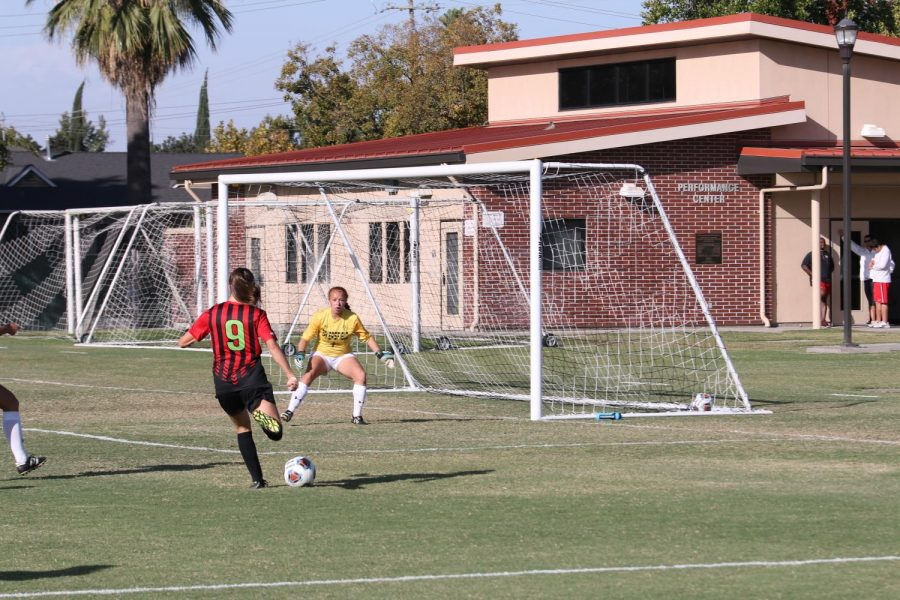 Fresno City College forward Raina Wristen takes a shot on goal during a home match against Bakersfield College on Tuesday Oct. 3, 2017.