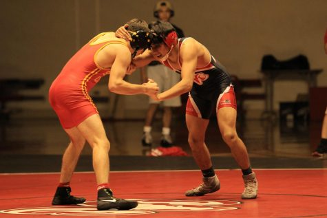 Fresno City College 125 pound wrestler Jacob Delgado locks up with his opponent from Skyline College during a recent dual meet at home on Saturday, Oct. 28, 2017.