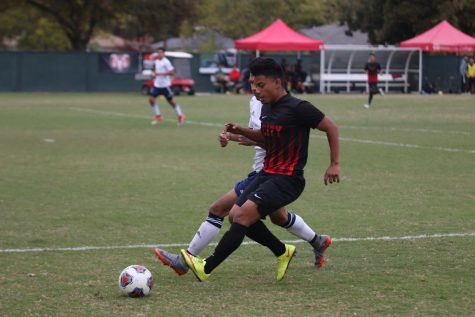 Fresno City College midfielder Julian Yepiz covers the ball from an opponent during a match against College of the Sequoias on Friday, Nov. 3, 2017.