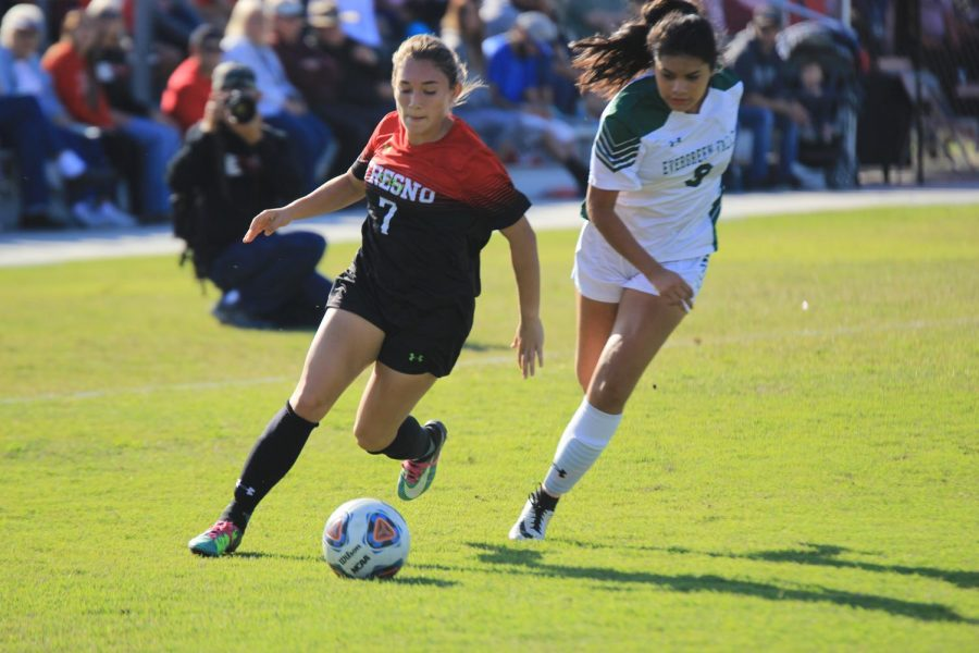 Fresno City College  forward Ashtyn Bracamonte gets past a Evergreen Valley College defender during a playoff match on Saturday, Nov. 18, 2017.