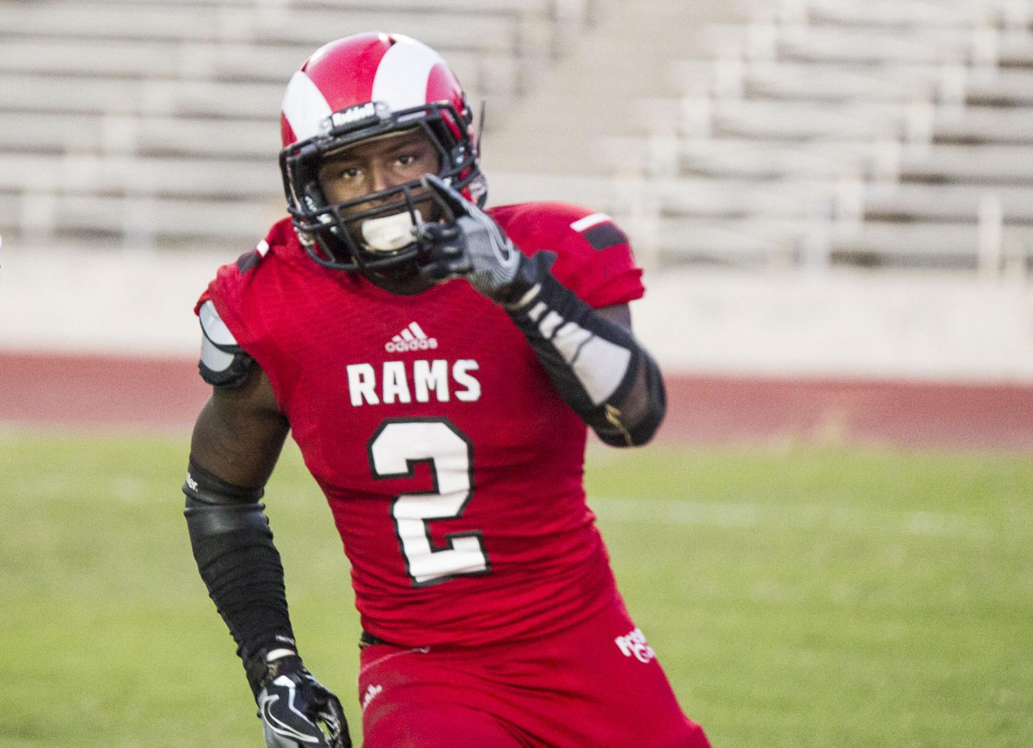 Fresno City College running back Khai Williams celebrates after scoring a touchdown during the State Center Bowl game against Butte College on Saturday, Nov. 18, 2017.
