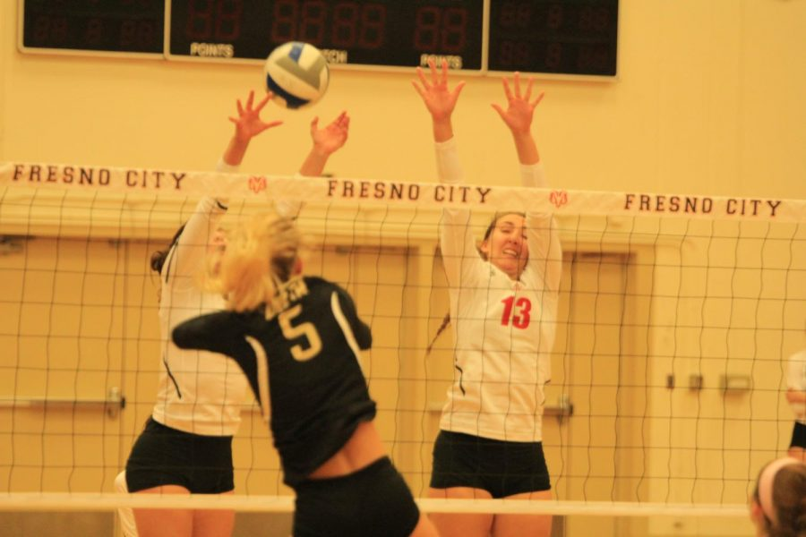 Fresno City College women's volleyball players get a block during a home match against San Joaquin Delta College on Saturday, Nov. 25, 2017.