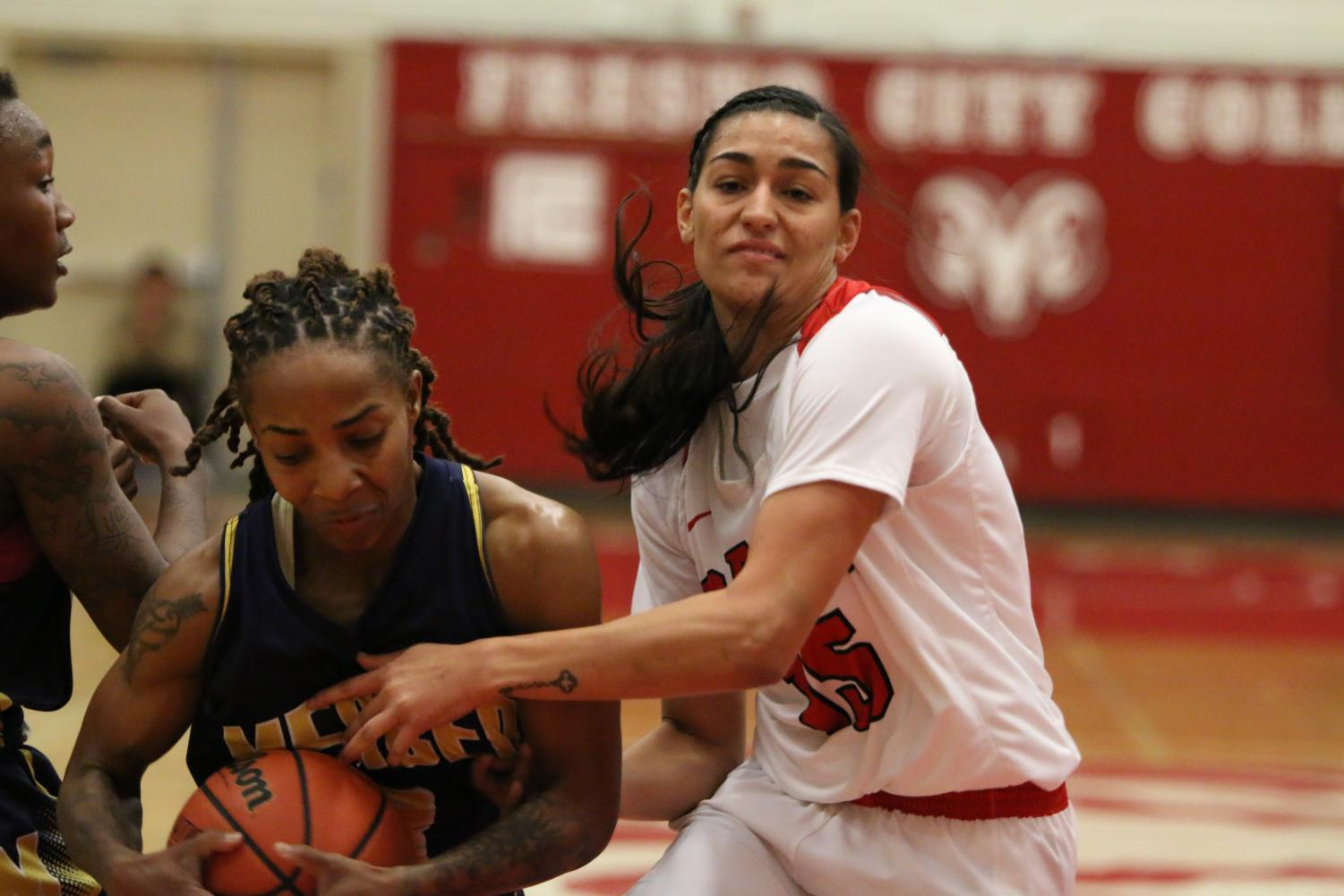 Fresno City College women's basketball guard Jasmine Phoolka gets the ball stolen from her by a Merced College player during the Fresno City Tournament championship game on Sunday, Dec. 10, 2017.