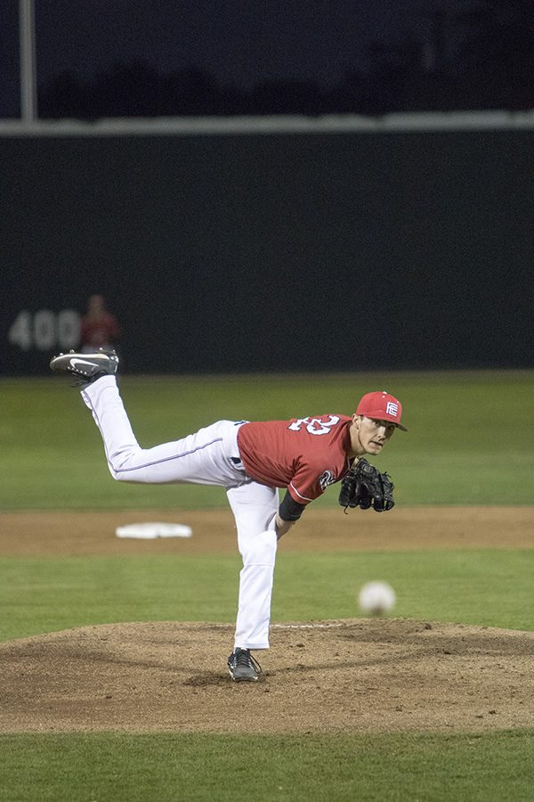 Pitcher Noah Parsons, throws a fast ball down the middle against a player from Sacramento City College on Friday Feb. 16, 2018.