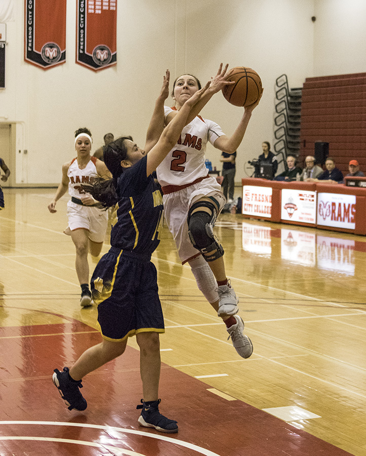 Sophmore Julia  Cuellar for the Rams driving to the basket against Merced College at Fresno City College Saturday. Feb. 17, 2018.
