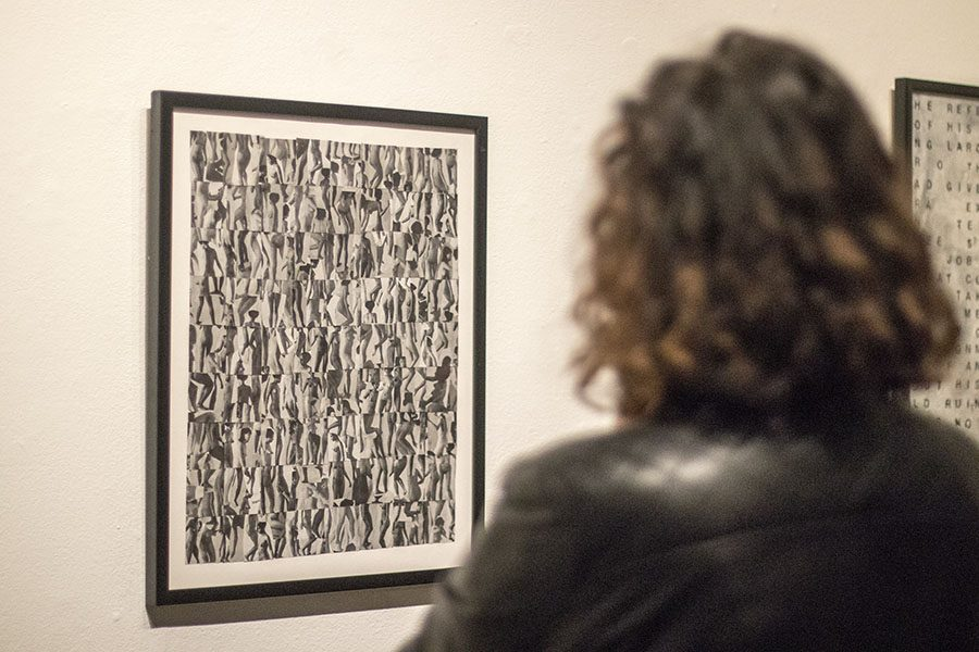 Fresno City College alumna Teresa Flores admires an untitled art piece by Carmen Winant in the art space gallery on Thursday, March 1, 2018.
