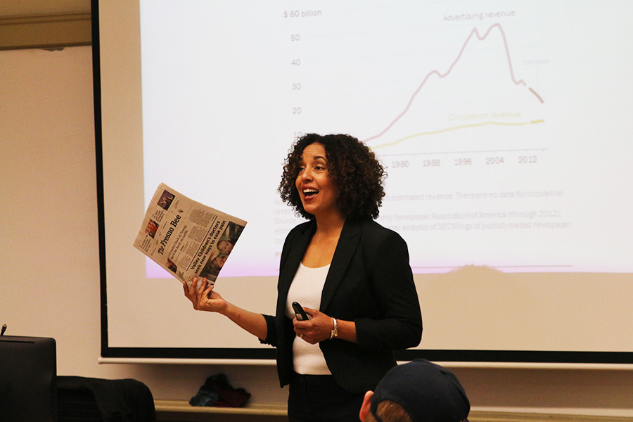 Fresno City College professor Kathleen Schock teaches her students about the history of newspapers on Tuesday, March 6, 2018.