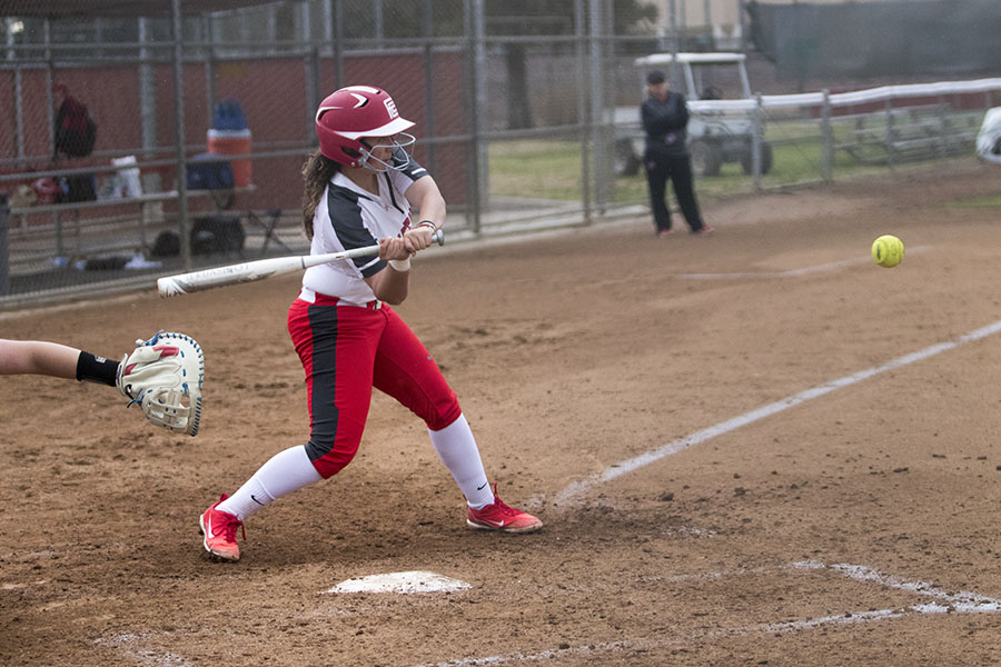 Outfielder freshman Daci Tovar hits a fastball thrown by a player from Siskiyous at Fresno City College on Saturday, March 3, 2018. Photo by Larry Valenzuela