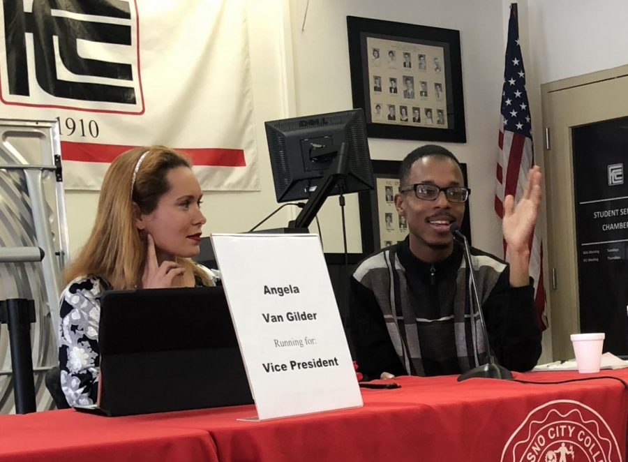 Angela Van Gilder (left), running for a vice president, and Christopher Washington, running for president, speak to students in the Student Lounge on Wednesday, April 18, 2018.