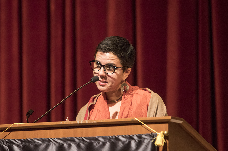 Keynote speaker Carmen Giménez Smith reads pieces from her new book during LitHop at Fresno City College on Saturday, April 21, 2018.