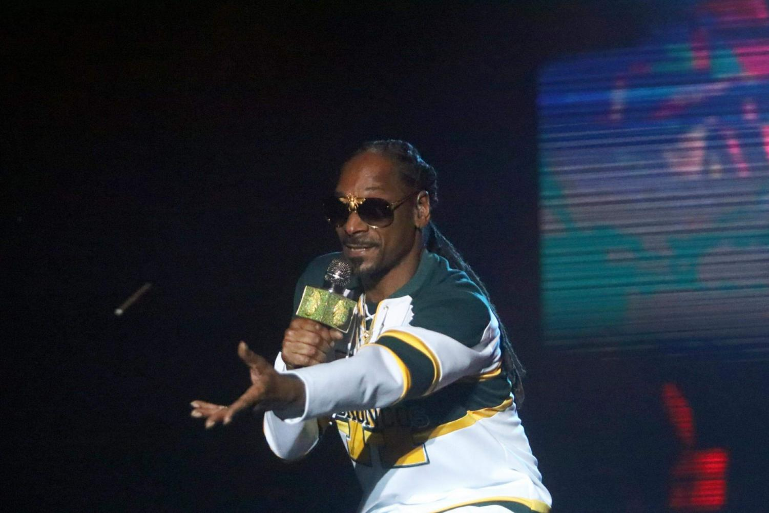 Rapper Snoop Dogg throws a blunt to members of the crowd as he headlines on the Yosemite stage on day two of Grizzly Fest, Friday, May 18.