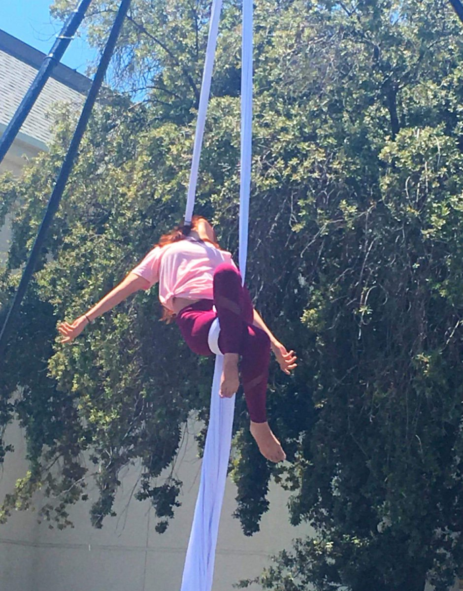 An aerial silk artist performs at the Fresno High Memorial Day Block Party, May 28, 2018.