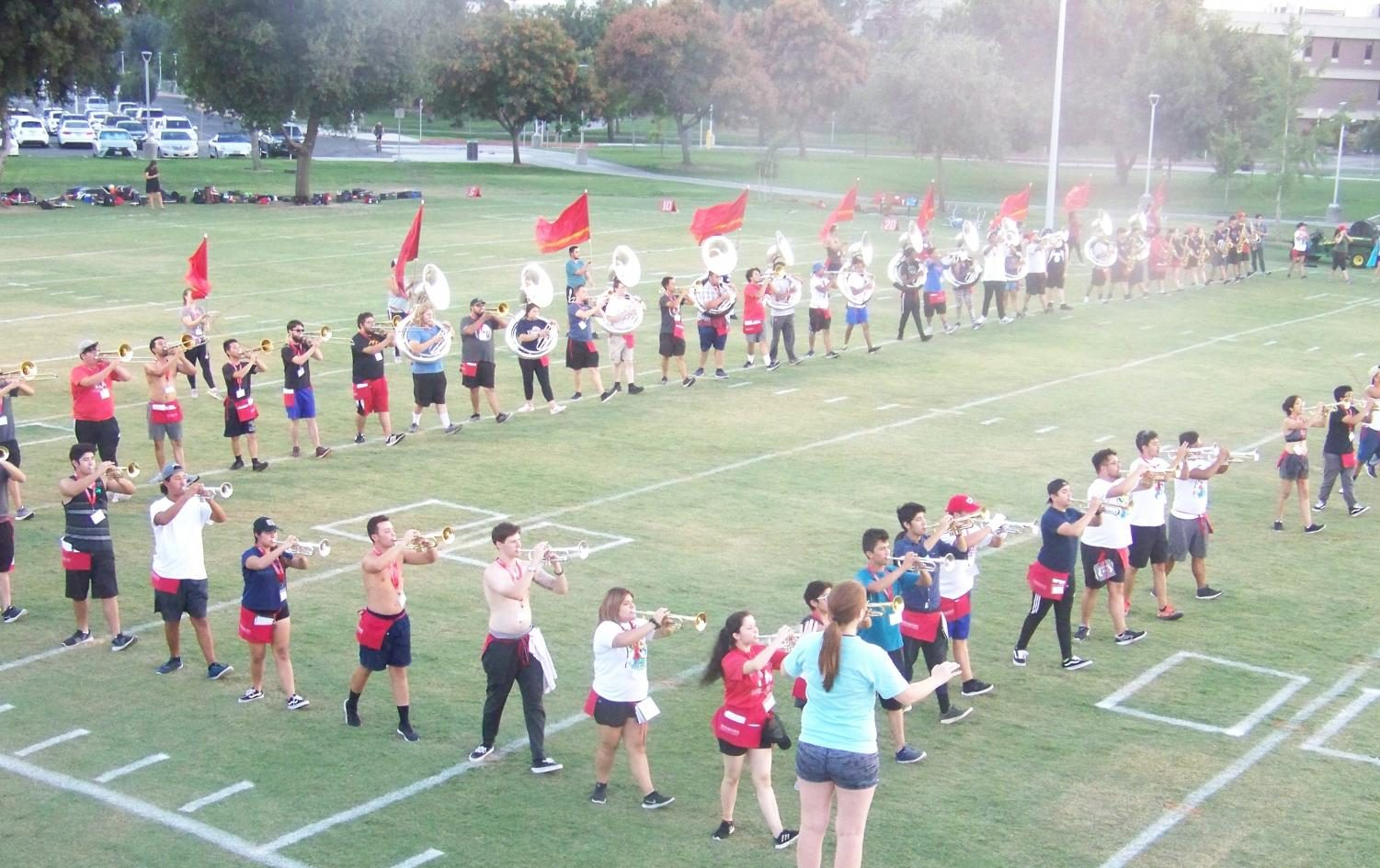 Fresno State marching band practices their formations at the Fresno State practice field on Saturday, Aug. 18, 2018