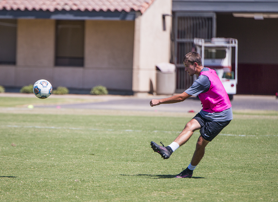 Defender Bryce Faber keeps the ball in bounds during practice for the Fresno College Ram's at Ratcliffe Stadium soccer field on Tuesday, Aug. 28, 2018. Photo by Larry Valenzuela