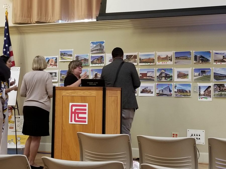 Fresno City College faculty review the architectural plans.