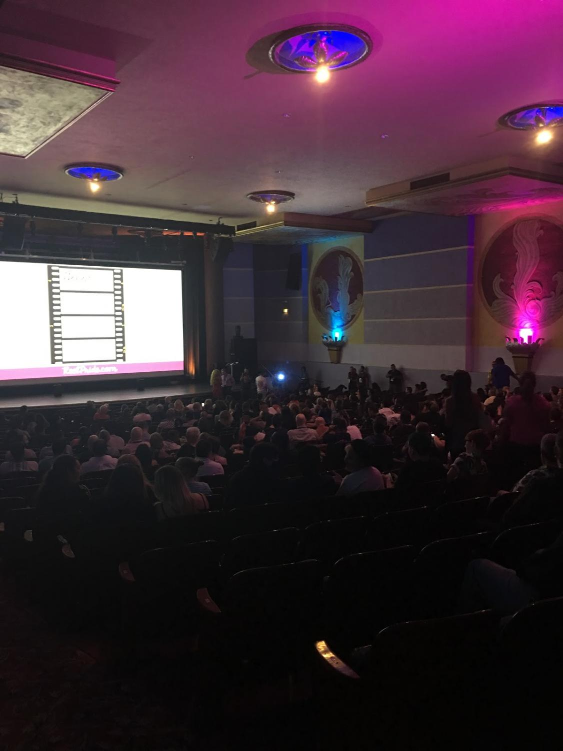 Audience preparing for the viewing of 'The Life of Lei: The Man Behind The Makeup' at Tower Theatre for Fresno Reel Pride Film Festival Thursday, Sept. 20, 2018.