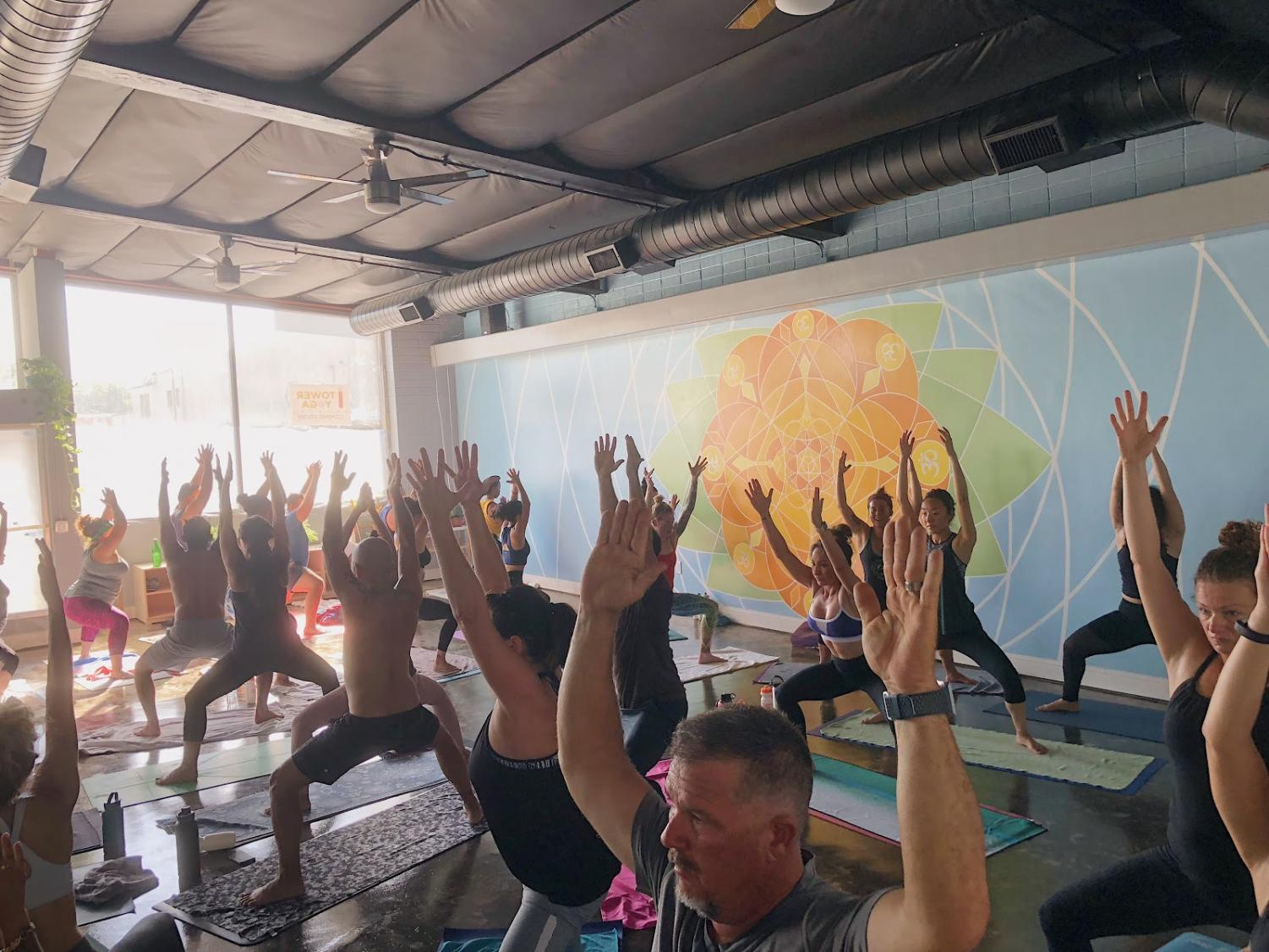 Tower Yoga patrons are 'striking a pose' in their Hot Vinyasa Flow Yoga Class on Saturday, Sept. 22, 2018.