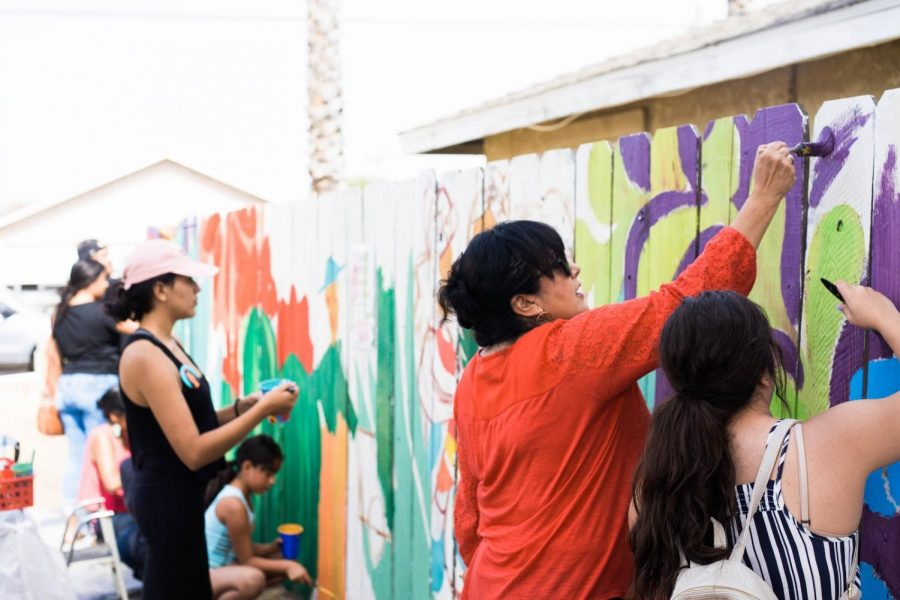 MPWR block party guests assist in a mural-painting effort on Sunday, Sept. 30 2018 in south-east Fresno.