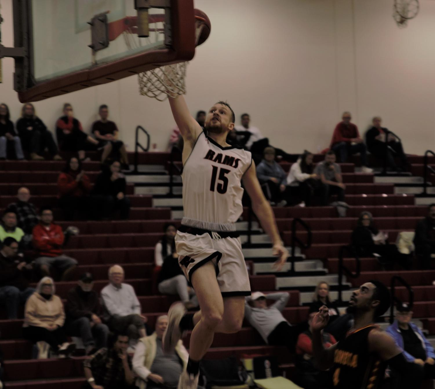 Ian Miller rises above the rim to score against Columbia College on Jan. 16, 2019.