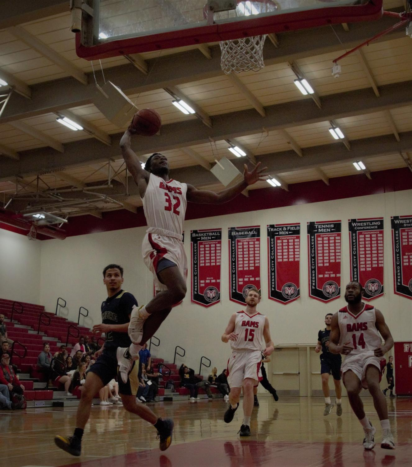 Freshman guard/forward Ronald Agebsar takes to the sky on his way to a dunk in the Rams' dominating 151-56 win over West Hills Lemoore on Jan. 30, 2019. Photo by Ben Hensley