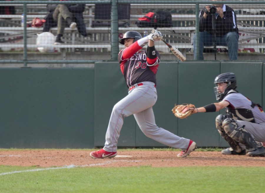 Marcus+Davis+takes+a+swing+at+a+pitch+during+the+Rams%27+doubleheader+against+the+Los+Medanos+Mustangs+on+Feb.+1%2C+2019.+Photo+by+Ben+Hensley