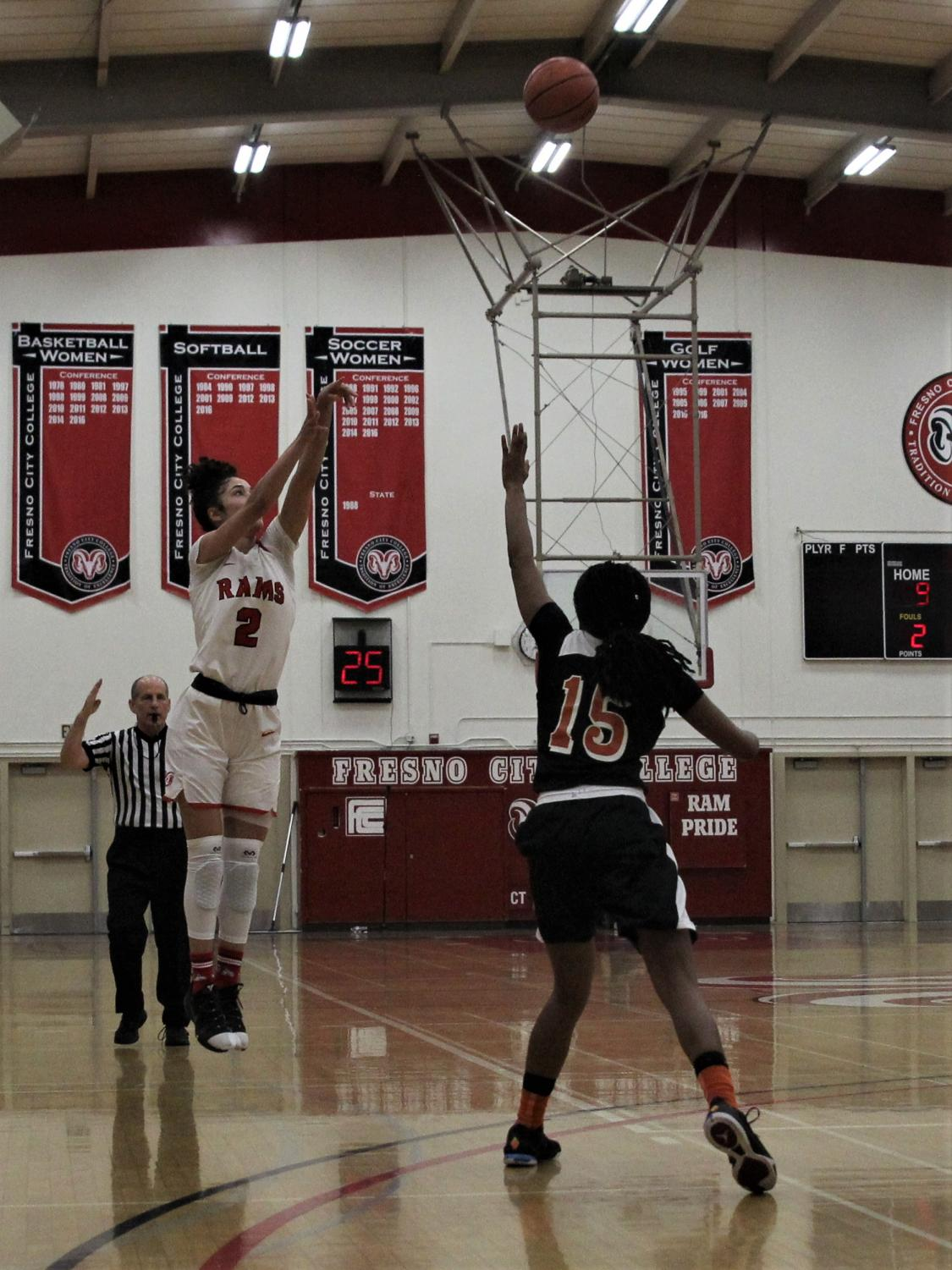 Penelope Kastsaridis puts up a three during the Rams' game against the Reedley Tigers on Feb. 20, 2019.
