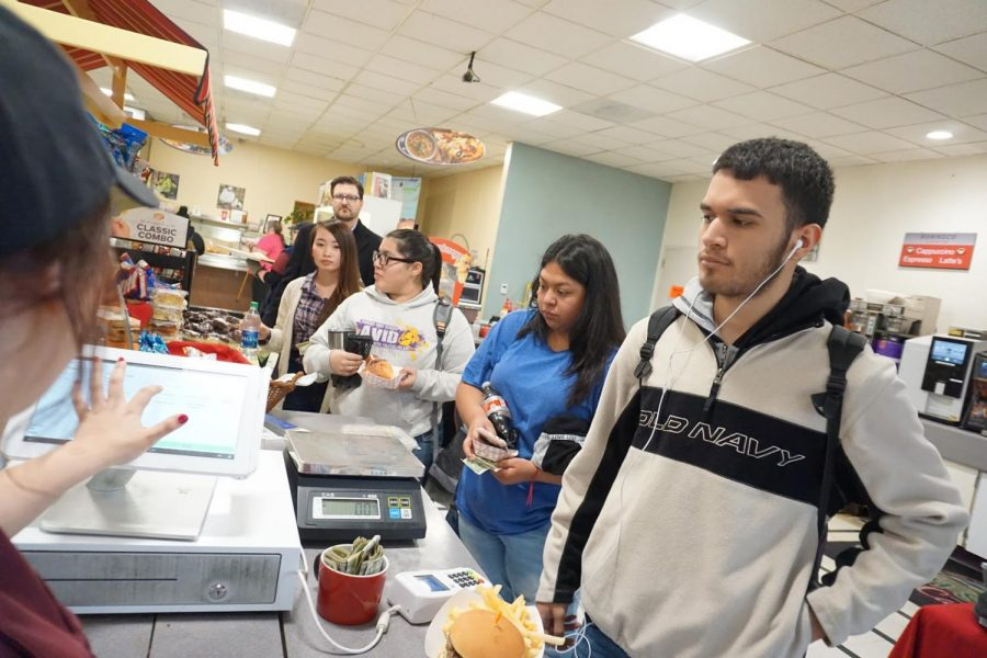 Students line up to buy food at the cafeteria on campus with their meal cards and coffee cards at Fresno City College.