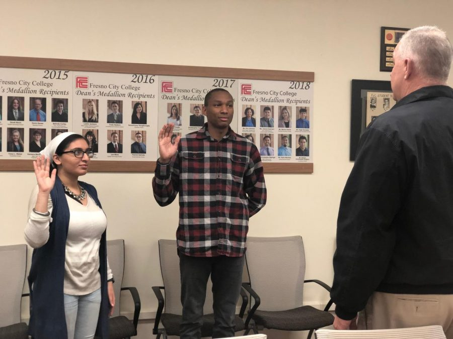 Dean of Students, Sean Henderson (right) swearing Senators Ruby Kaur (left) and Henry Evans (middle) into office in the FCC Senate Chambers on Feb. 12, 2019.