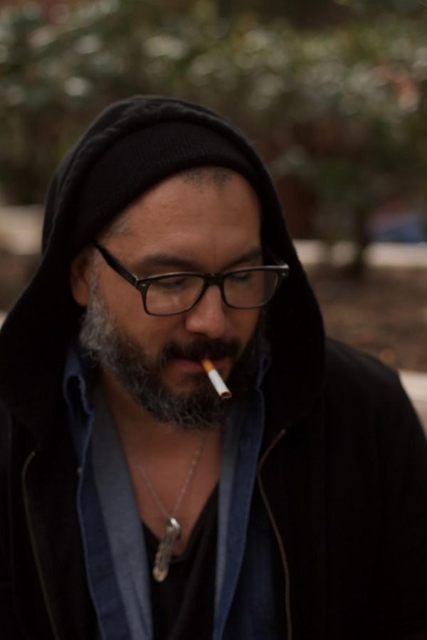 Music major Ray Silva, 36, smoking natural tobacco to relieve stress in FCCs designated smoking area.