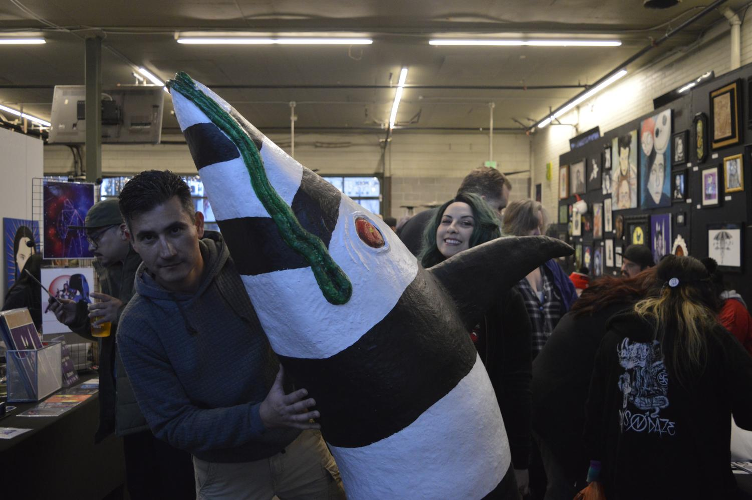David and Caroline Vicchio prepare their 5' tall sandworm at Tioga Sequoia Brewing at a Tim Burton art Tribute on Saturday March 2.