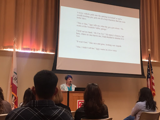 "Laurel Doud reading excerpts from her unpublished novel ""Inch Worm"" at ""The Language of the Brag: Celebrating Women Writers"" event, honoring women during Women's History Month March 21, 2019 in OAB 251."