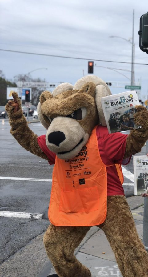 Rammie, FCC's Mascot, standing out on the corner of Blackstone and McKinley asking for Kids Day donations of for the newspaper March 5, 2019.