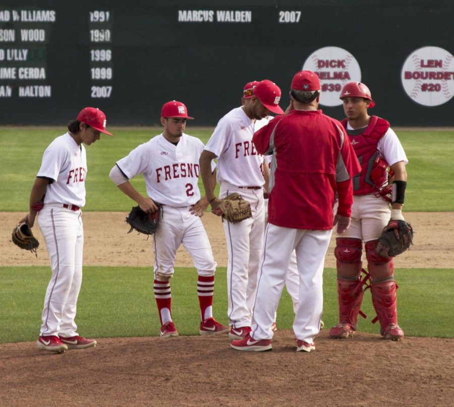 Rams' pitching coach Eric Solberg meets with Giovanni Saavedra and the rest of the infield on the mound during the Rams' 9-3 loss to COS on Tuesday, March 26 2019 at John Euless Park.