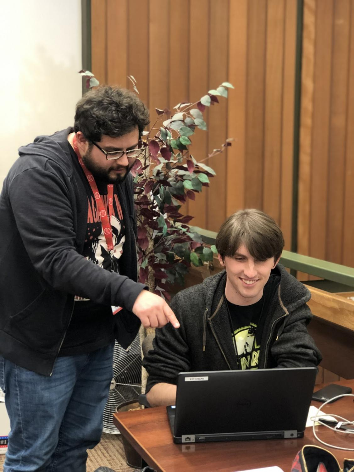 Cody Hoover, left, adjunct instructor from the English department and tutor at the reading and writing center. Jonah Schneider, right, four year student and third year tutor at the reading and writing center, Tuesday, March 12.