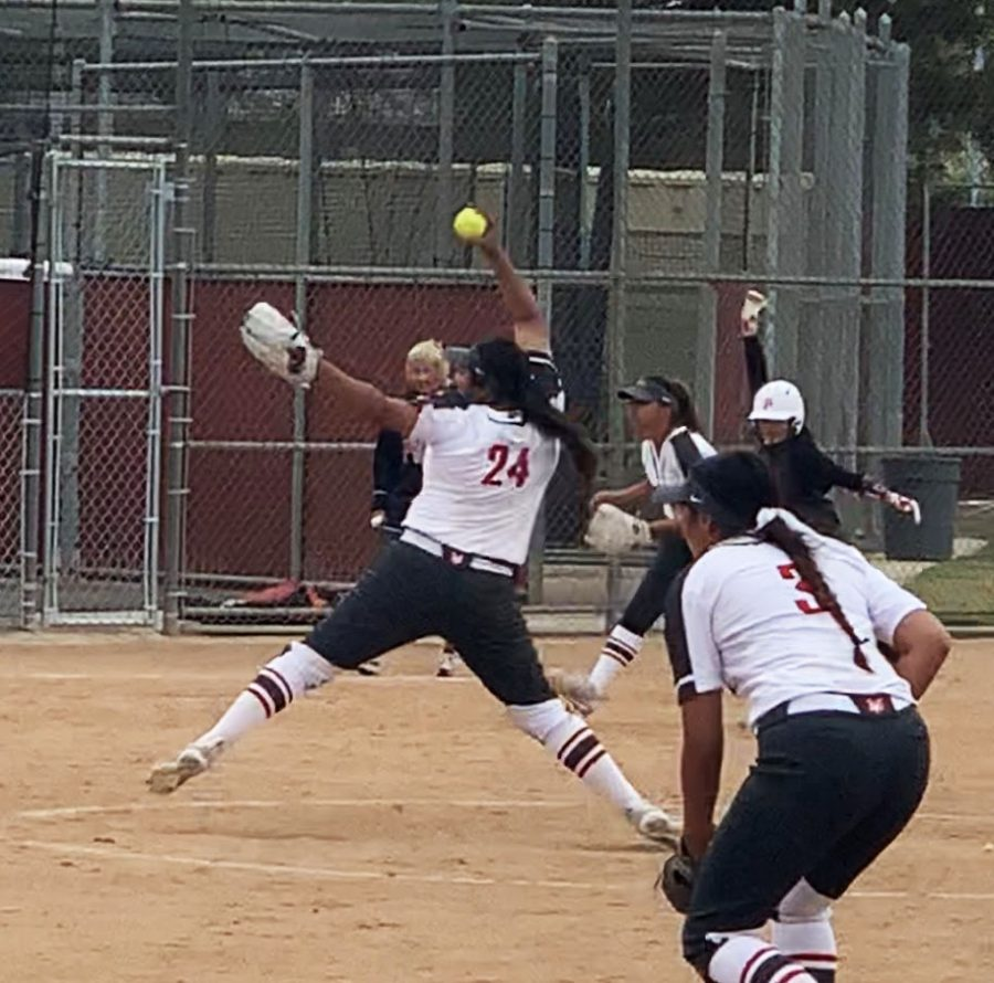 Freshman+pitcher+Emily+Puente+throws+a+pitch+in+the+eighth+inning+against+Porterville+College+on+April+7+at+FCC+Softball+Diamond.+Puente+would+throw+4+%E2%85%93+innings+of+relief+giving+up+three+hits+and+two+unearned+runs+while+striking+out+four.