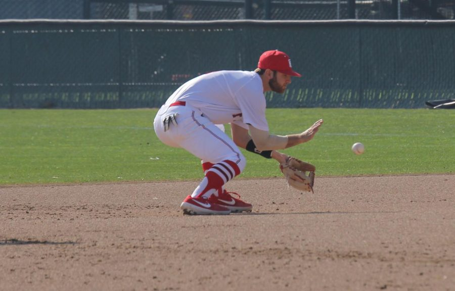 Ian Ross cleanly fields a ground ball during the Rams' game against Feather River College on Jan. 27, 2019.