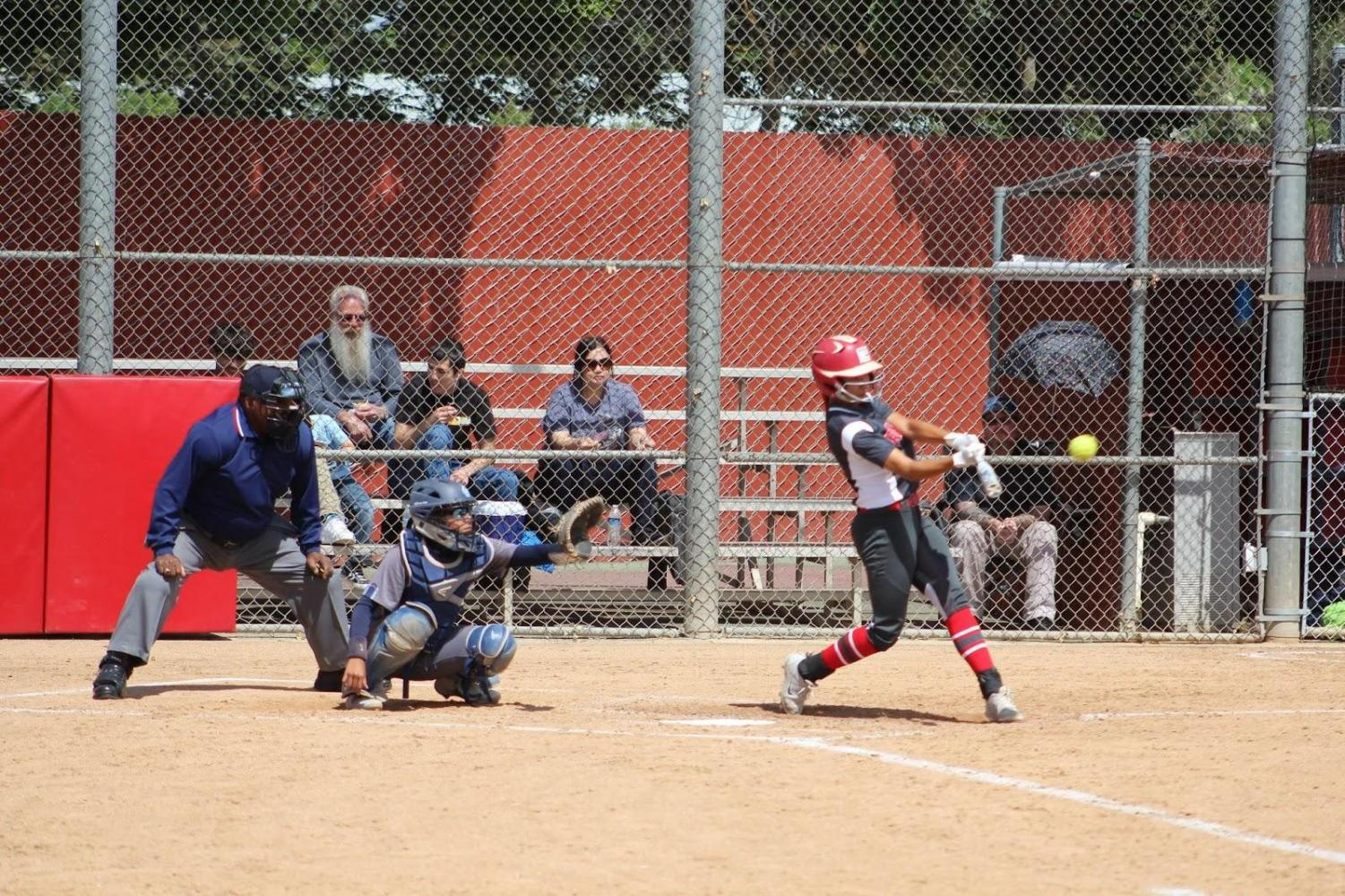 Fresno City College center fielder Savanna Pena belts a double during the Rams' game against Cerro Coso on April 16, 2019 at the FCC Softball Diamond.