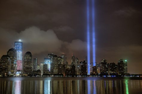 "The ""Tribute in Light,"" an art installation of 88 searchlights placed six blocks south of the World Trade Center. The twin beams of light commemorate the 9/11 attacks. For those that lived through the attacks, the lights memorialize a skyline eternally scarred. For those born after, the lights are all that ever was. Photo courtesy of Flickr."