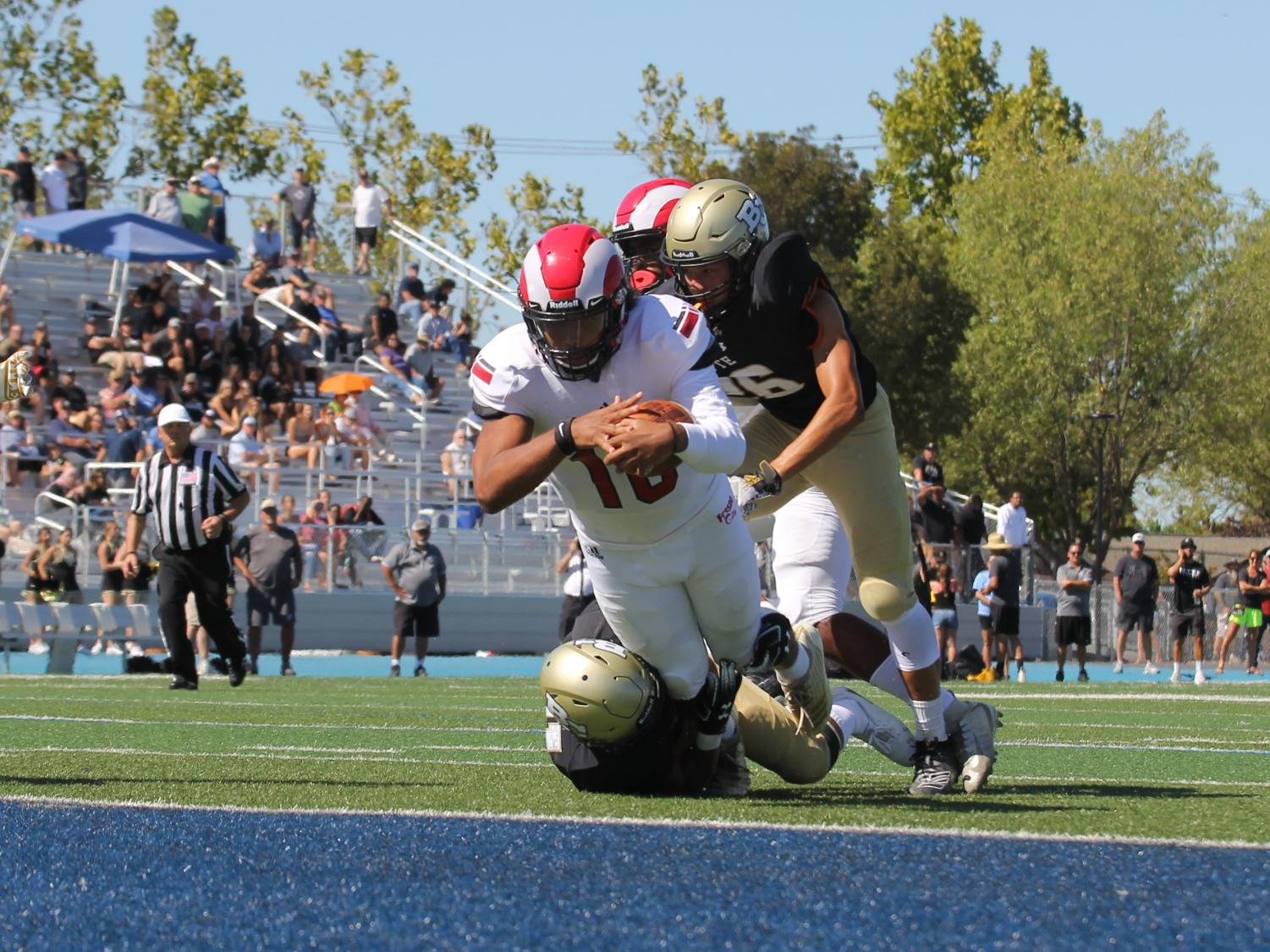 Sophomore quarterback Jonah Johnson dives into the end zone during the Rams thrilling 13-10 win over the Butte College Roadrunners on Sept. 21, 2019.
