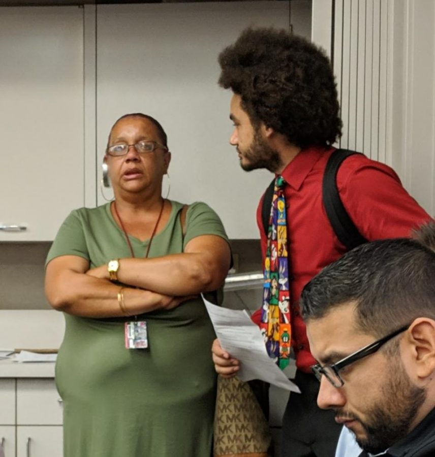 ASG president DeRon Walker, right, listens to FCC student Lola Gayles' frustrations with the lack of supplies at the FCC bookstore during the SCCCD school board meeting on Sep. 3, 2019 on FCC campus.