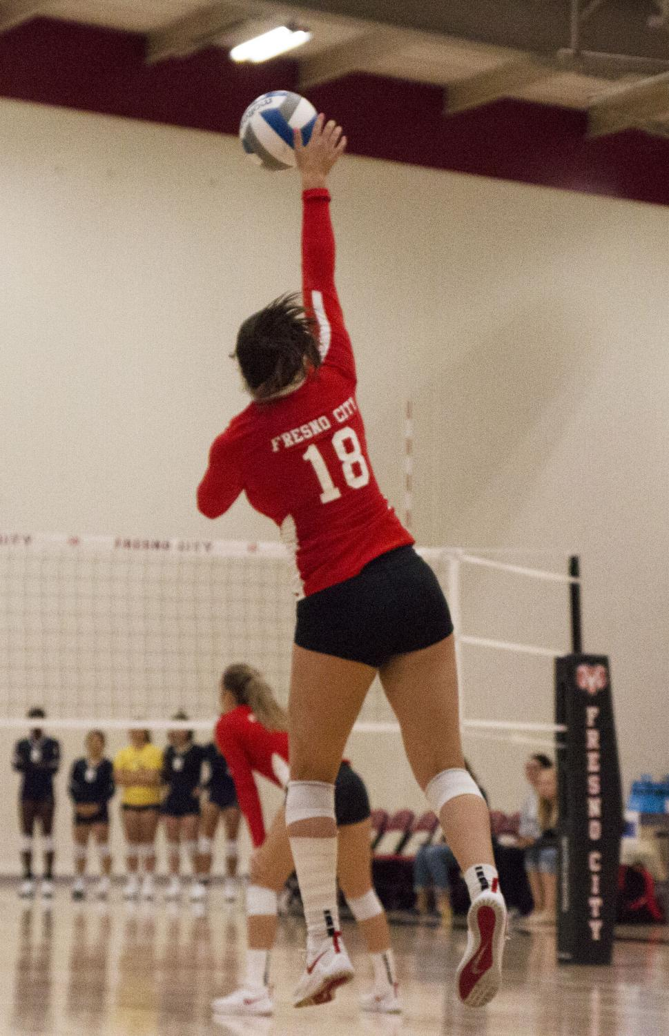Rams' freshman pin setter Taylor Dilley serves during the Rams' 3-0 set shutout against the Merced College Blue Devils on Sept. 20, 2019.
