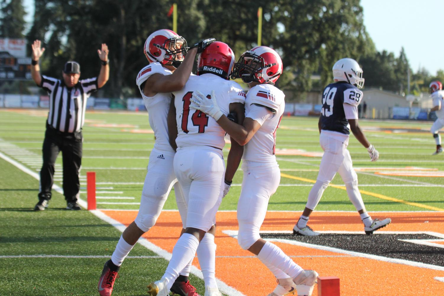 Rams sophomore wide receiver Chris Brown celebrates with teammates following a 14-yard touchdown completion from sophomore Quarterback Jonah Johnson on Sept. 7, 2019. The Rams defeated Santa Rosa Junior College 35-17 in their season opener.