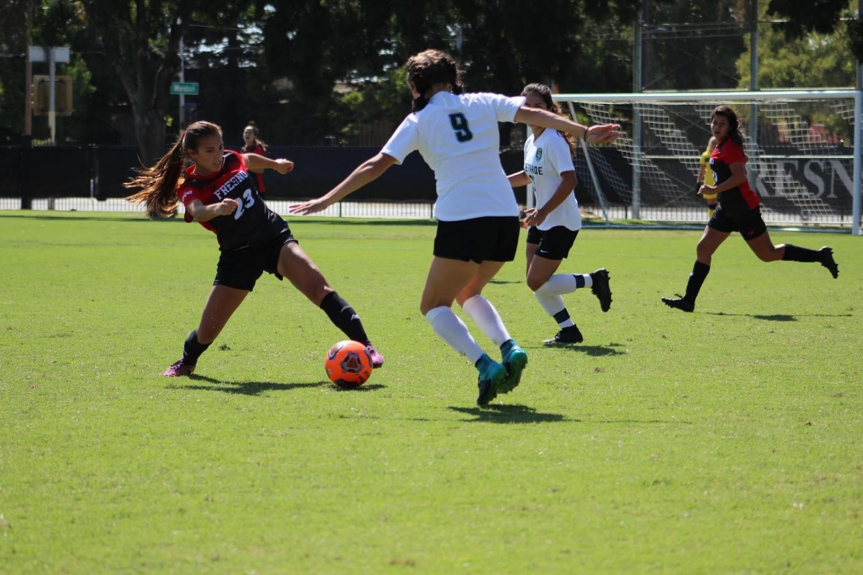 Rams freshman forward Megan Galvan slips past midfielder Melanie Ara in a 1-1 tie against Lake Tahoe on Sept. 20, 2019.