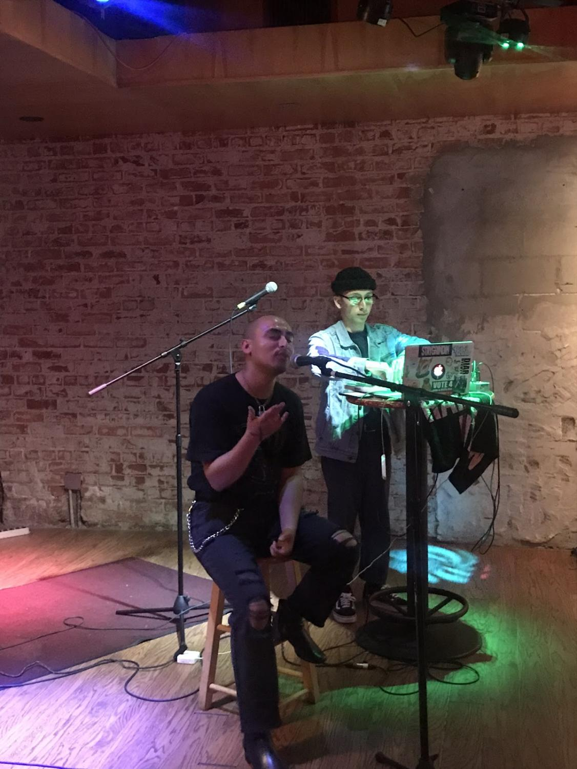 Performer Maximus Mendoza (left) and DJ Nate Ruiz (right) flow together at Strummers' Monday Mixer on Oct. 14, 2019.