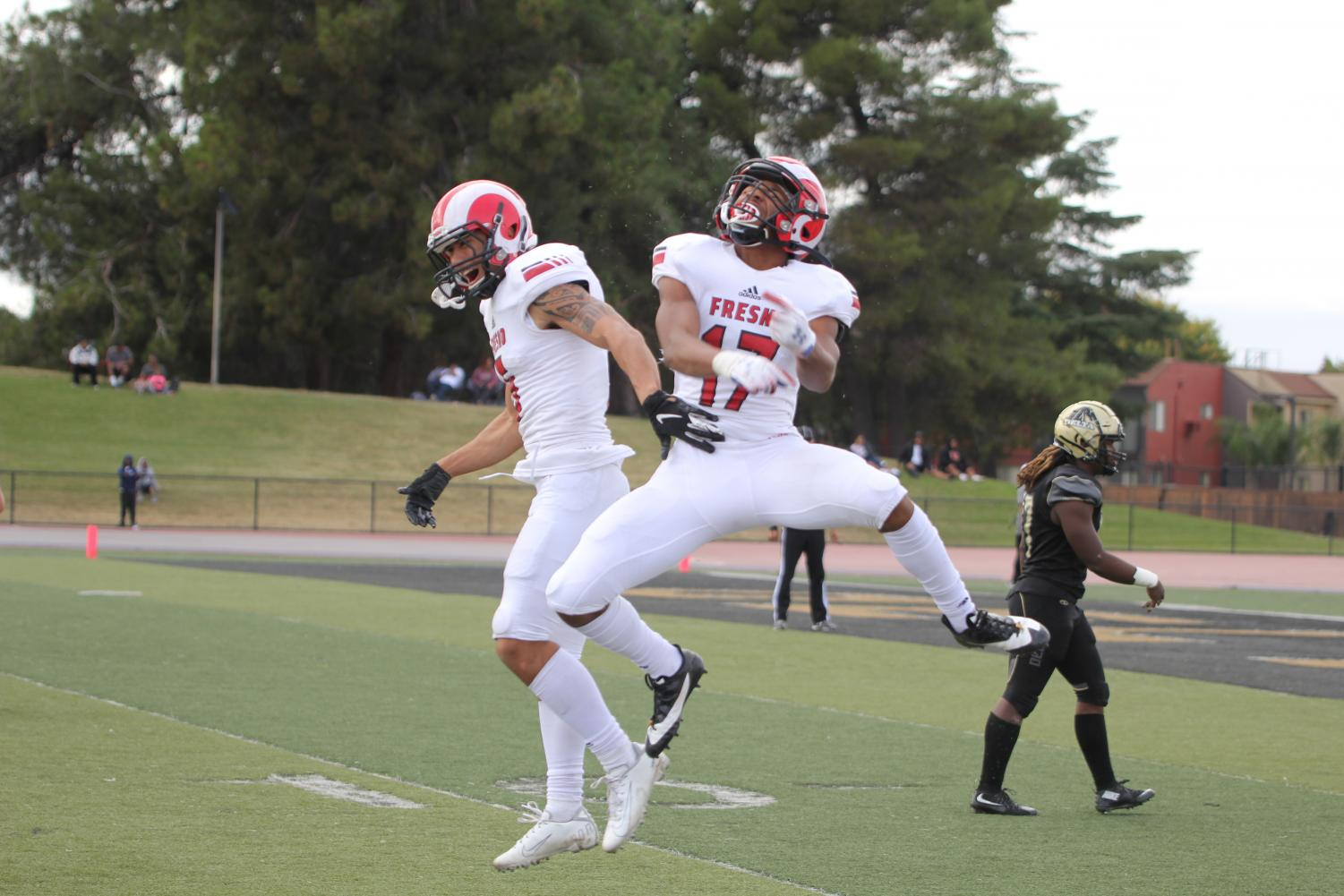 Austin Aukia (left) and Milton Clements (right) celebrate a touchdown on Oct. 19, 2019