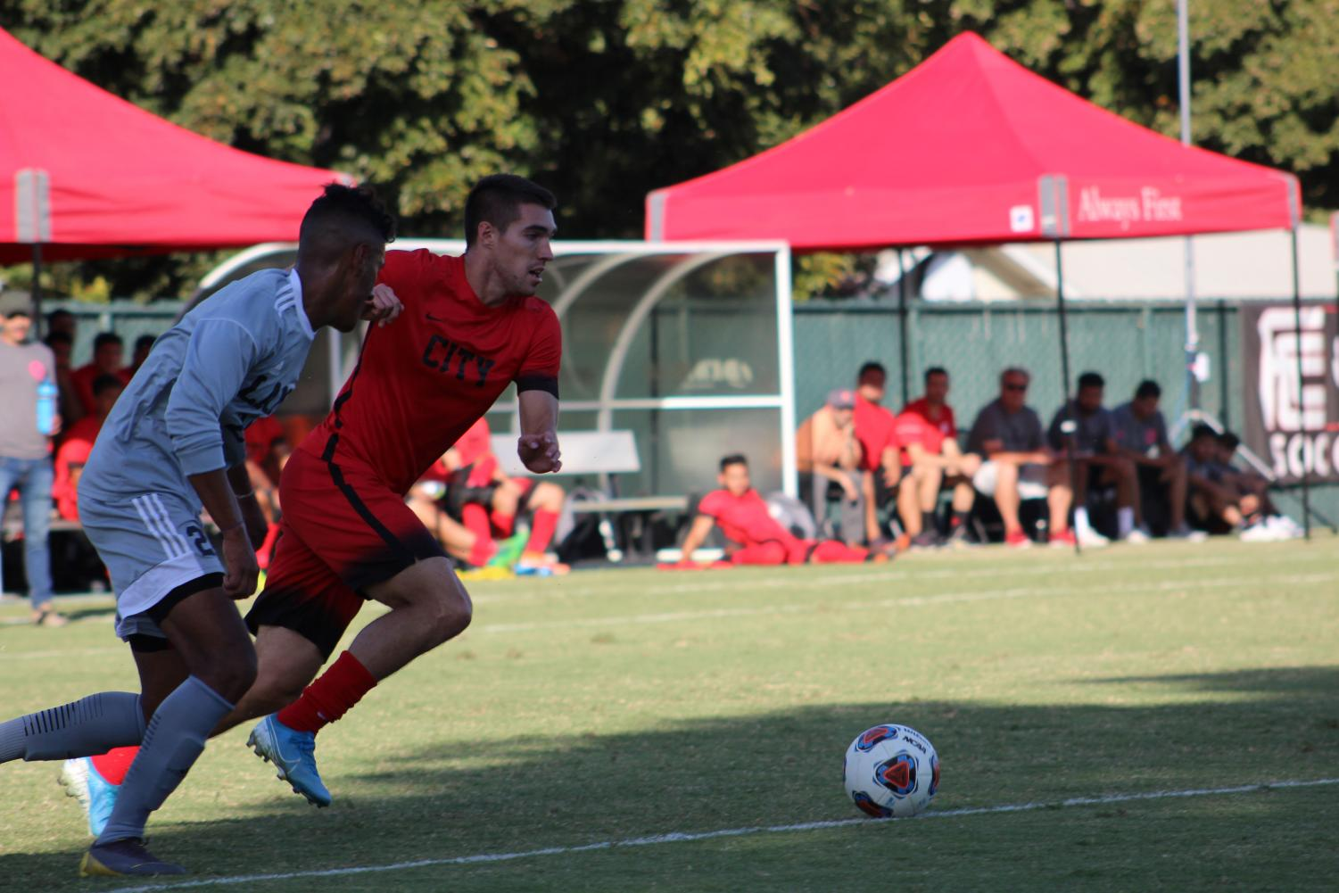 Rams' sophomore forward Mason Gonzalez outruns LA an Mission College defender during the Rams' 5-0 win on Tuesday, Oct. 8,.