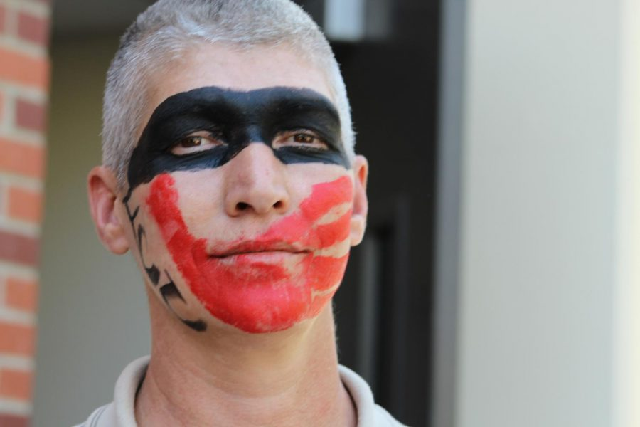 FCC student Robert Davis of the Cherokee tribe shows his support with face paint at the Indigenous People's Day rally on Oct. 14, 2019 symbolizing the awareness of missing and murdered indigenous women.