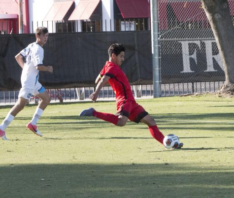Sophomore midfielder Eduardo Segura passes to an inside teammate in the Rams' match on Tuesday, Oct. 1.
