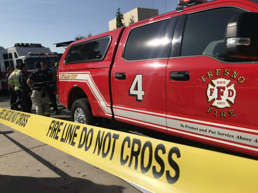 Police and Fresno Fire Department keep the area clear as students are treated and the FCC Math and Science Building is evacuated at 10 a.m. on Thursday, Oct. 10, 2019, following a chemical spill.